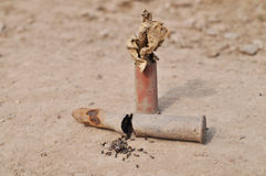 Rusty cartridge with gunpowder Stock Images