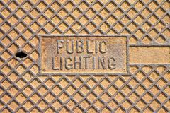 Rusty cast iron manhole covers for utility structures and public. Lighting royalty free stock images
