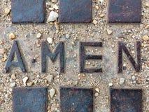 Rusty cast sewer, men, amen stock photo