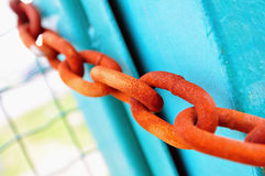 Rusty chain. Photo of rusty chain on green gate Stock Image