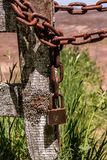 A rusty chain and an ancient padlock stock photos