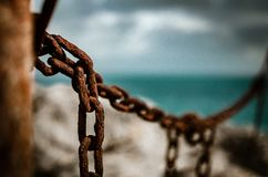 Rusty chain on a blurry bukeh background royalty free stock photography