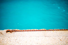 Rusty chain on the concrete with water Stock Photo