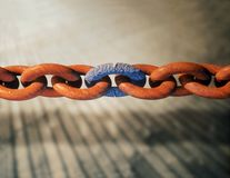 Rusty chain with a corroded weak link Stock Image