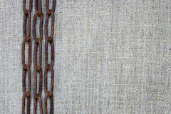 Rusty chain on fabric. Rusty chain on rough fabric Stock Image