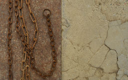Rusty chain on iron sheet Royalty Free Stock Images