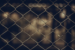 Rusty Chain Link Fence of steel netting on blur background. Royalty Free Stock Images