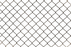 Rusty chain link fencing isolated on white background. Metal fence diamond pattern stock photo