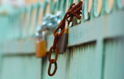 Rusty chain lock rounded on fence Stock Photo