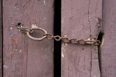 Rusty chain on an old barn door Royalty Free Stock Photo