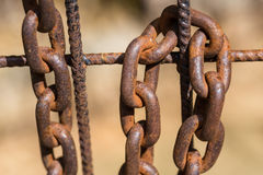 Rusty chain on an old metal fence Royalty Free Stock Photo