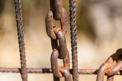 Rusty chain on an old metal fence Royalty Free Stock Photos