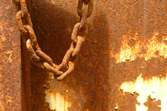 Rusty chain over rusty background Royalty Free Stock Image