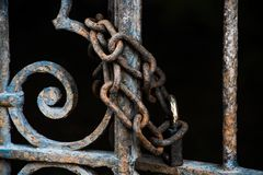 Rusty chain with padlock on the vintage gate stock images