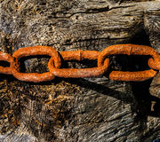 Rusty Chain on textured background Stock Photography