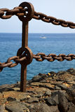 Rusty chain  water  boat yacht coastline and summer in lanzarote Royalty Free Stock Image