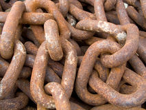 Rusty chains. Pile of rusted chains at a boatyard Stock Images