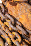 Rusty chains. On a harbour wall Stock Photo
