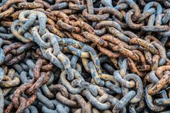 Chains of the past pile up in a heap stock photos