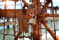 The rusty chains and old lock door Stock Images