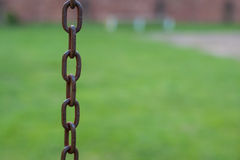 Rusty Chains. In an outdoor park Stock Photography