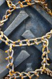 Rusty chains on vehicle close-up Stock Photos