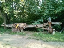Chassis of old Landrover in grass. Rusty chassis and suspension of four wheel drive Landrover in on grass stock images