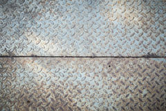Rusty checkered steel plates texture Stock Image