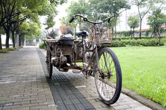 Rusty Chinese tricycle Stock Photo