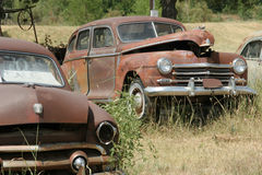Rusty classic American car. S at the junk yard Royalty Free Stock Photography