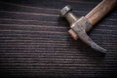 Rusty claw hammer on vintage wooden board Stock Images