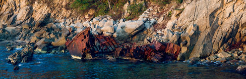 Rusty coastal shipwreck  Stock Photos