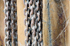 Rusty and cobwebbed chains Stock Photo