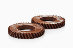 Rusty cog wheels on white background Stock Photography
