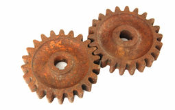 Rusty cogs. Old rusty gear cogs isolated on white background Stock Image