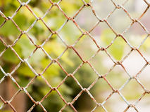 Rusty colored mesh netting. The metal fence Royalty Free Stock Photo