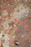 Rusty colored metal with cracked paint background Royalty Free Stock Image