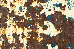 Rusty Colored Metal with cracked paint, grunge background Royalty Free Stock Photo