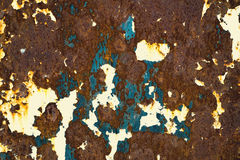 Rusty Colored Metal with cracked paint, grunge background Royalty Free Stock Photos