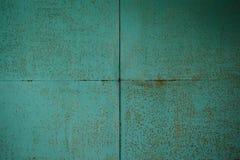 Rusty Colored Metal med sprucken målarfärg, grungebakgrund royaltyfria foton