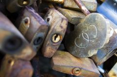 Rusty and colorful love locks wall, double heart lock, selective focus, space for text stock photography