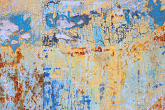 Rusty colorful Metal with cracked paint. Royalty Free Stock Image