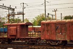 A rusty coloured Indian goods train guards compartment tied with goods train stock photography