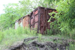 Rusty container. Outdoorsrngreen naturernon a hill Royalty Free Stock Photo