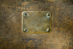 Rusty copper name plate. Rusty copper name plate on wood background Royalty Free Stock Photos