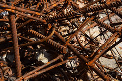 Rusty corroded stained metal pieces: wire, fitting, armature on a dirty concrete Stock Photography