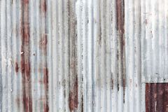 Rusty corrugated galvanized steel iron metal sheet surface for texture and background stock image