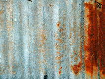 A rusty corrugated iron metal fence. Close up/ Zinc wall stock photography
