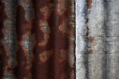 Rusty corrugated iron texture. Textured surface of corrugated iron with contrasting rusty red and silver grey colours. Close up detail of old farm building Royalty Free Stock Photography
