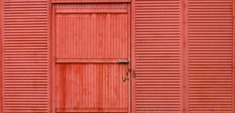 Rusty corrugated metal red wall and door Stock Photo